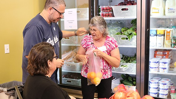 volunteers bagging vegetables in the Corner Market
