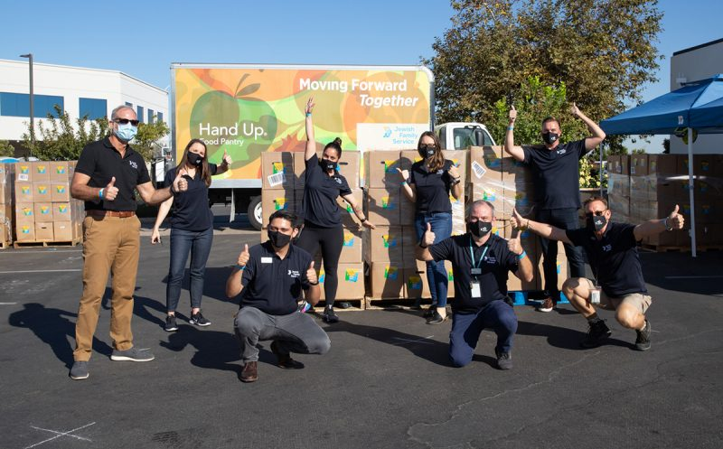 photo of JFS volunteers posing in front of Hand Up delivery truck